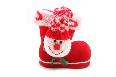 botas de navidad: botas rojas de Navidad en un fondo blanco Foto de archivo