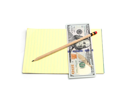 yellow notebook, pencil and money photo