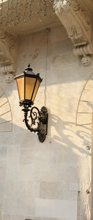 The lantern on the wall photo