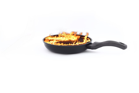 Frying pan on a white background with a burning fire photo