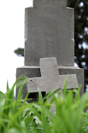 empty tomb: old cement cross on the cemetery