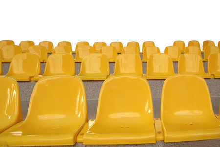 arranging chairs: yellow plastic seats on the rostrum Stock Photo