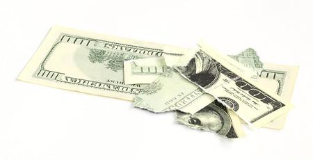 hundred dollar bill: torn a hundred dollar bill