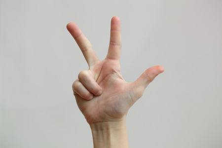 three fingers: three fingers of the hand on a gray background