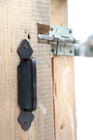 latch: brass latch on wooden gate