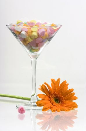 i mate: Candies in martini glass with a flower Stock Photo