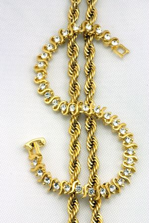 priceless: Golden chain and bracelet Stock Photo