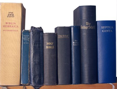 holy god: Shelf of Bibles in different versions and languages
