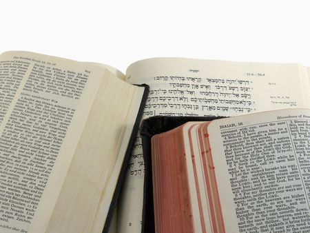 English (KJV), German, and Hebrew Bibles open to Isaiah 55, with  Stock Photo