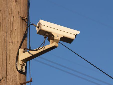 utility pole: Security camera mounted on a utility pole