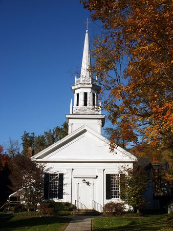 lattice window: New England style church in autumn