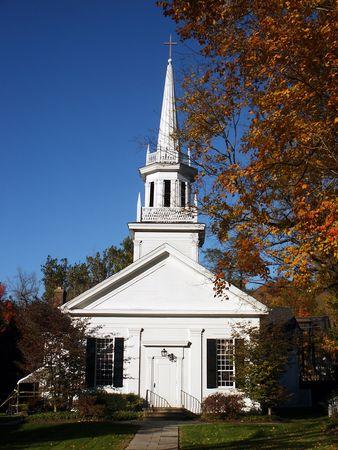 lattice window: New England style church in autumn