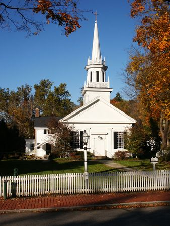 lattice window: New England style church with picket fence
