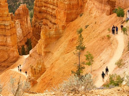 intentionally: Switchback trail in Bryce Canyon with hikers (some faces intentionally blurred) Stock Photo