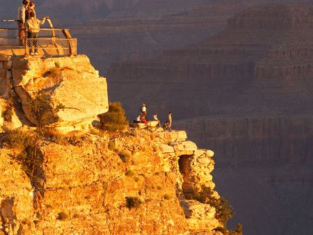 sightseers: People gathered at Hopi Point on the Grand Canyon to watch the sunrise Stock Photo