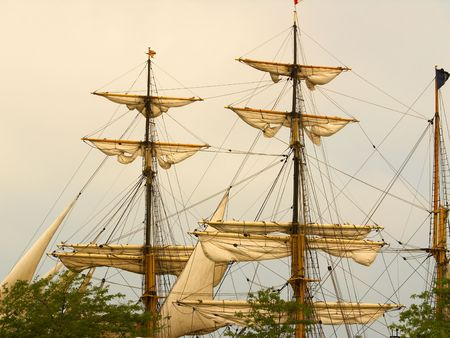 barque: Sails of a tall ship (barque) in warm light