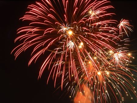 Several bursts of fireworks in a summer display Stock Photo