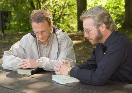 Two men praying together Stock Photo - 570856