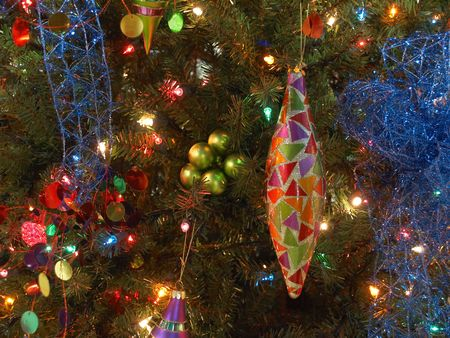teardrop: Teardrop shaped ornament on brightly decorated Christmas tree Stock Photo