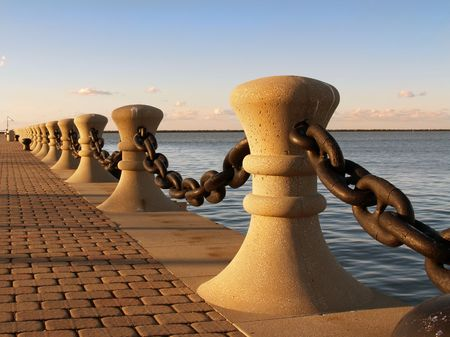 along: Bollards and chain along harbor front