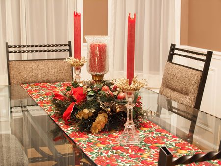 A dining room decorated for the holidays photo