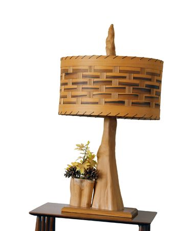 lamp shade: Lamp on a wooden stand with wooden shade Stock Photo