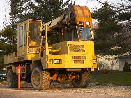 roadwork: Roadwork excavator at rest in evening sunlight