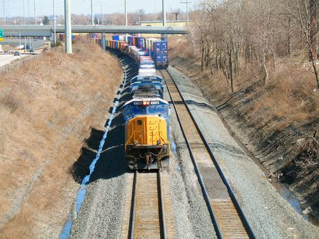 Oncoming freight train rounding a curve with back end of second train