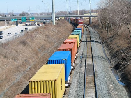 Freight cars with trailers on a train passing below