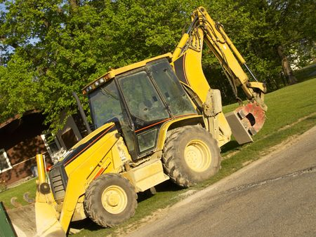 smoother: Front-end loader with scoop and leveler, angled Stock Photo