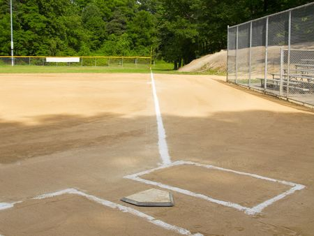foul: Home plate and first base foul line on a small-town ball diamond