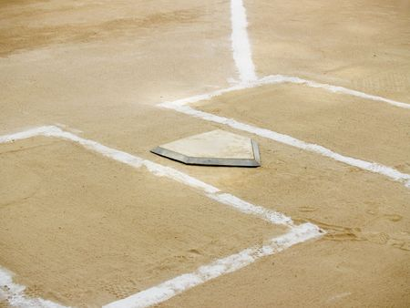 plate: Home plate and chalk lines on a baseball diamond