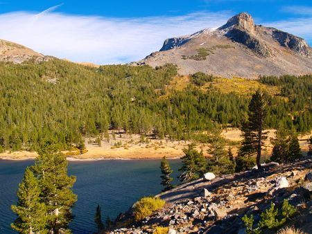 Tioga Lake and mountains in the high country of Yosemite National Park photo