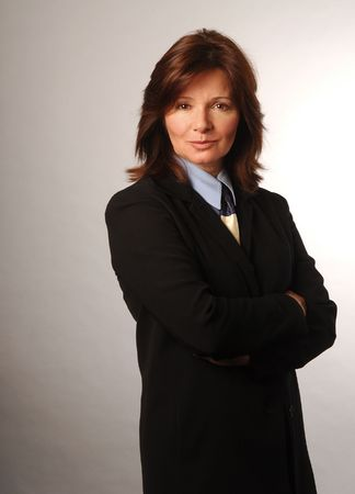 tough: Businesswoman in black suit looking determined and sharp Stock Photo