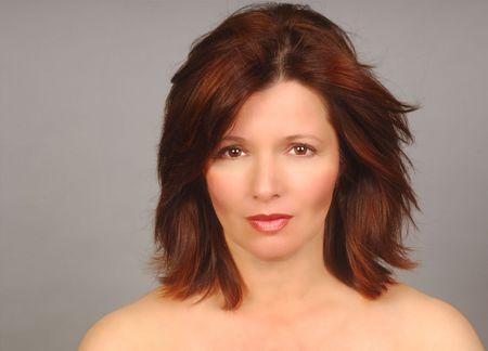 lustrous: Glamorous head shot of a pretty woman Stock Photo
