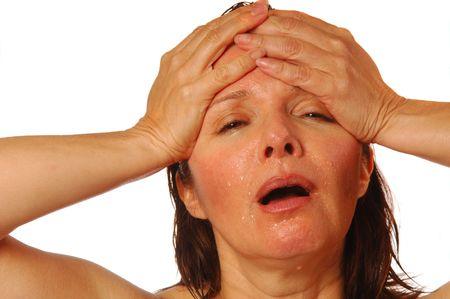 splitting headache: Woman with splitting headache holding hands on forehead