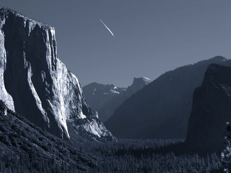 Jet trail over Yosemite Valley, monochrome, slightly blue-toned       photo