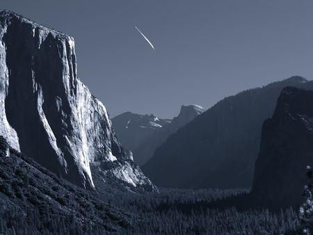 Jet trail over Yosemite Valley, monochrome, slightly blue-toned       photo