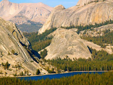 sierras: Sheer cliffs of the High Sierras above Tenaya Lake in Yosemite National Park Stock Photo