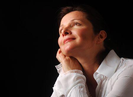 Beautiful woman gazing upward with a feeling of joyful contentment