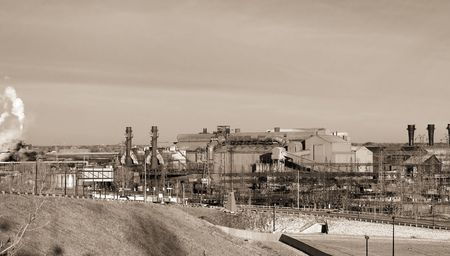 mill valley: Sepia-toned view of old steel mill in an industrial valley