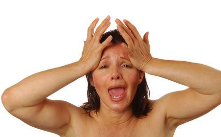 splitting headache: Woman holding her head in agony, shock, or grief