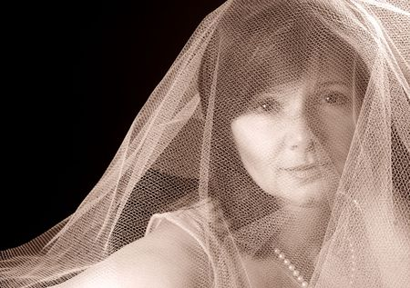 gauzy: Beautiful lady under a gauzy veil, sepia toned Stock Photo