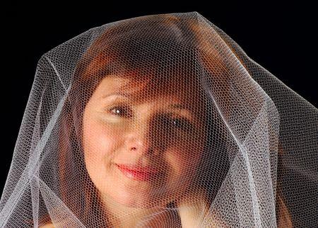 gauzy: Beautiful young woman under a gauzy veil Stock Photo