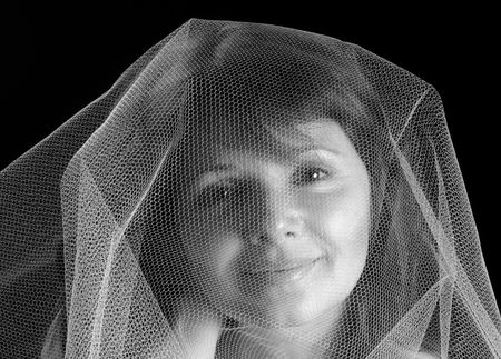gauzy: Beautiful young woman under a gauzy veil, black and white Stock Photo