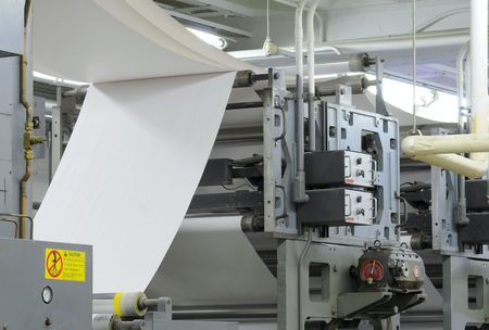 Paper threading its way through a printing press Stock Photo