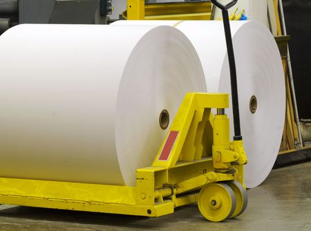 commerce and industry: Giant paper rolls waiting to be put on a printing press