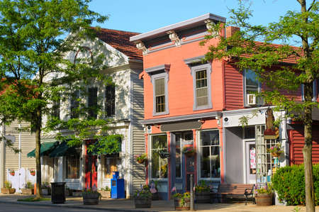 Quaint shops in bright morning sunlight on historic Main Street of Hudson, Ohio Stock Photo