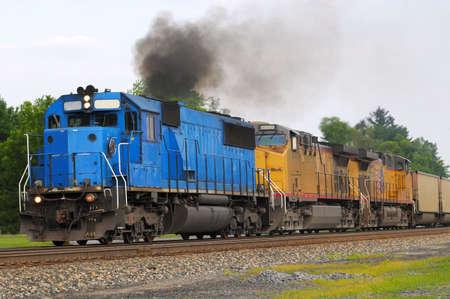 spewing: Diesel locomotive spewing a cloud of smoke Stock Photo