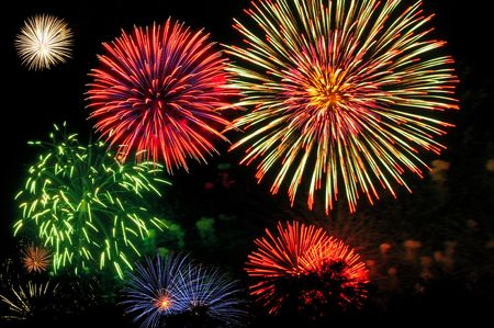 panoply: Night sky full of colorful Fourth of July fireworks Stock Photo